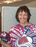 Stan loses a bet and has to dye his hair brown and wear a Colorado Avalanche shirt all day - 2002