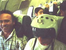 Stan with Mig fighter pilot helmet over pinko hair on Aeroflot flight to Moscow - the crew were not amused - 1999
